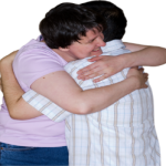 Two people embracing.