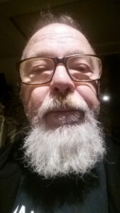 Man with glasses and a long white beard
