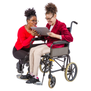 Two women, one a wheelchair user, working together on an iPad.